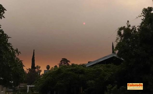 moon-shaped sun by smoke