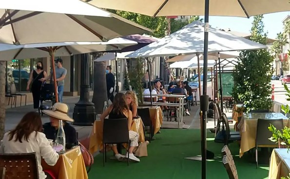 people dining under a tent
