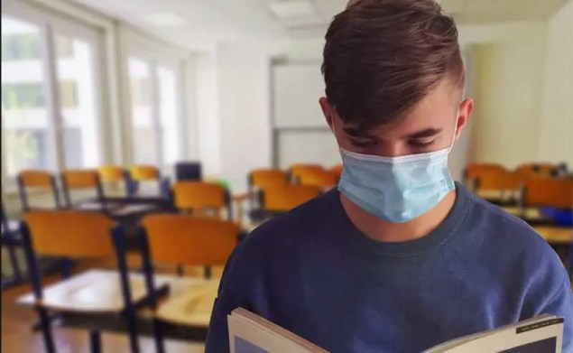 a student with a mask