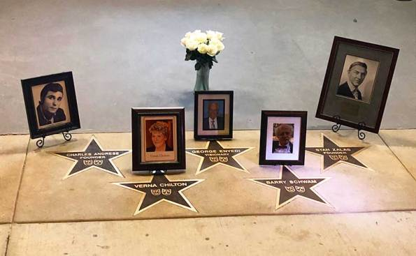 photos in frames in front of stars in ground