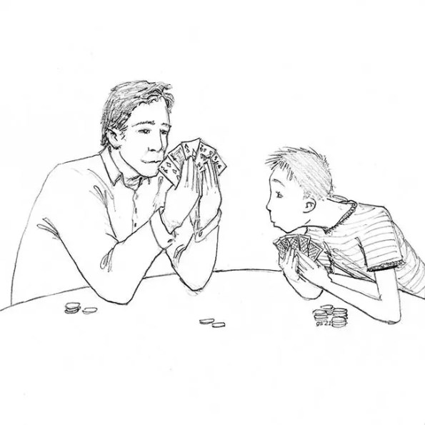 A father and son playing a card game