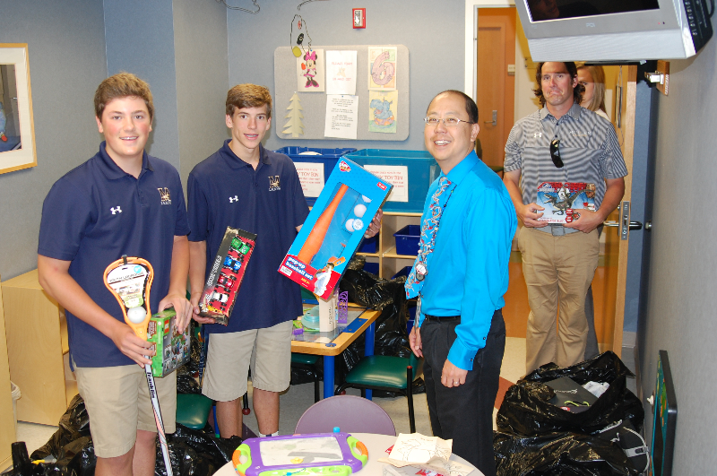 Mullen lacrosse gives toys to pediatric cancer patients