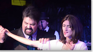 Erik Wilkins as Libretto Santiago and Nancy Stohlman as Ursula Leonard