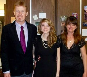 Daniel Pierce is pictured here with his wife, Debra and her daughter, Kayla, whom he helped raise, between them. (Photo courtesy of Debra Pierce)
