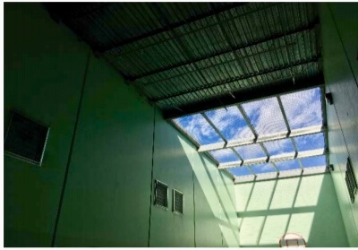 """Outdoor recreation"" at the Aurora Detention Facility takes place in a cell with partially open ceiling. Courtesy of ICE"