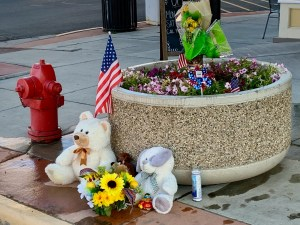 Alamosa residents left tokens of the concern for Danny Pruitt following his shooting, uncertain if he would survive. (Photo by Susan Greene)