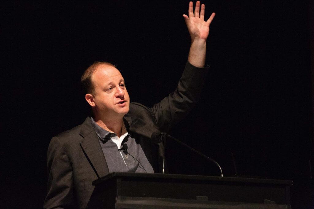 Jared Polis addresses a Boulder crowd in 2018. (Photo by Phil Cherner)