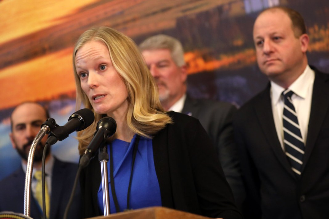 Rachel Herlihy, communicable disease epidemiologist, speaks at a press conference with Gov. Jared Polis Tuesday, March 3 at the governor's office about state preparedness regarding the novel coronavirus.