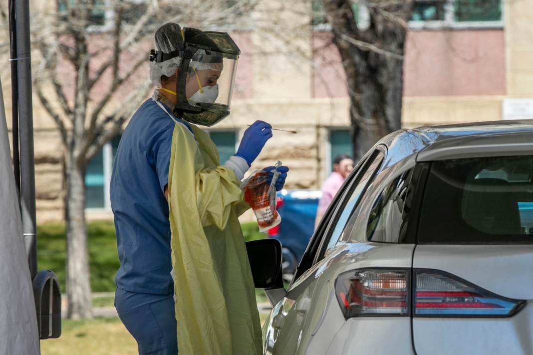 Front-line health care workers attend to people accessing the drive-through coronavirus testing bay at National Jewish Health in Denver, Monday, April 27, 2020. (Photo courtesy of CPR News)