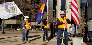 Construction workers show support for expanded overtime protections outside of the Colorado Department of Labor and Employment on Dec. 16, 2019. (Photo by Forest Wilson)
