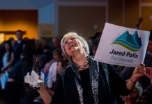 A Jared Polis supporter celebrates his gubernatorial win on Nov. 6, 2018. (Photo by Evan Semón)