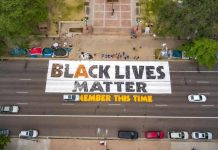 """""""Black Lives Matter, remember this time"""" street mural on Broadway between Colfax and 14th Avenues on June 13, 2020."""