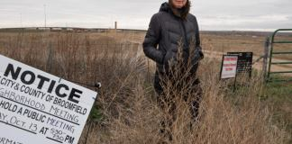 Lois VanderKooi, part of a Broomfield community group hoping to pass Question 301, stands in front of the Interchange Pad, the first location Extraction Oil plans to develop. (Ted Wood/The Story Group).