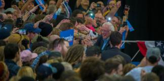 Democratic presidential primary candidate Bernie Sanders greets supporters at the Colorado Convention Center on Feb. 16, 2020. Sanders won Colorado's caucuses in 2016 and visited the state Sunday in advance of the March 3, 2020 Super Tuesday primary. Thousands of people crammed the Convention Center to hear him speak. (Photo by Evan Semón, www.evansemon.com)