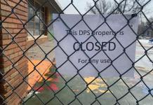 """A """"closed"""" sign on the gate at Carson Elementary School in Denver on April 3, 2020. On Monday, April 20, 2020, Gov. Jared Polis announced that all Colorado schools will remain closed for the rest of the academic year."""