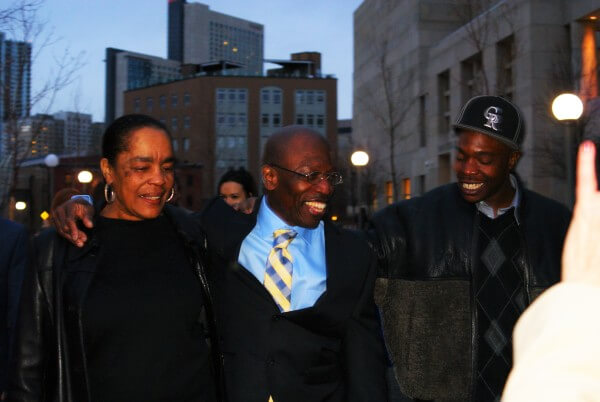 Moses-EL and his wife and son celebrate his freedom. Photo: Robert McGoey