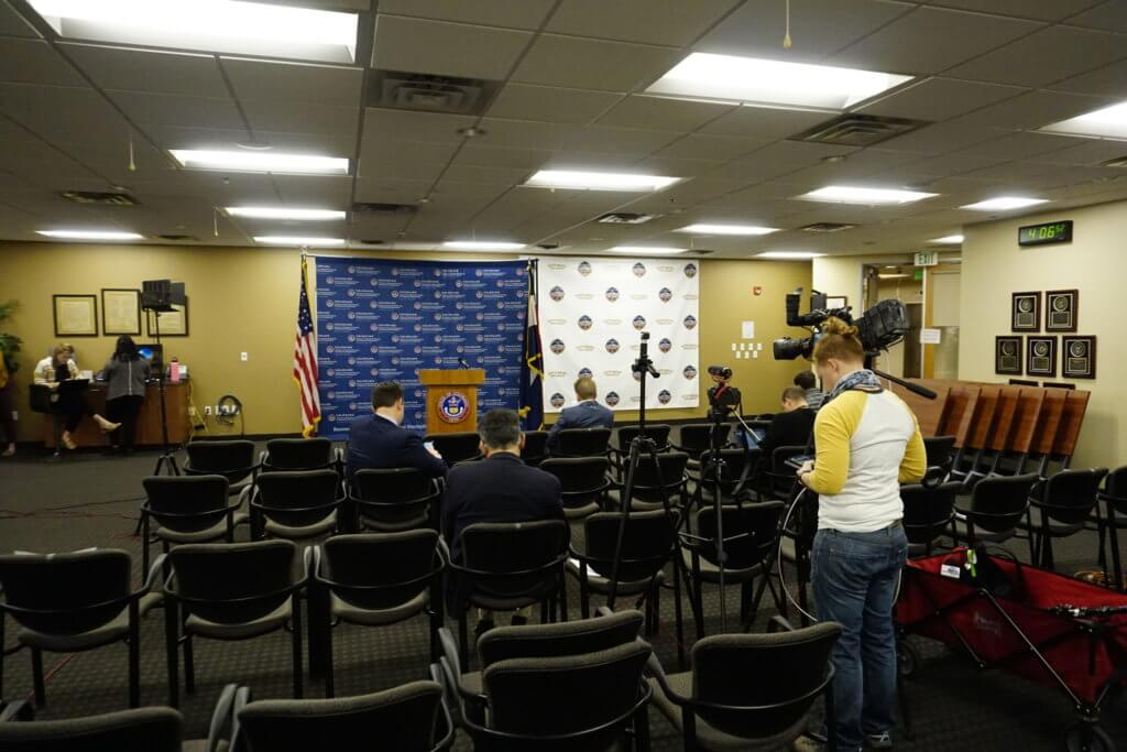 Reporters wait for Gov. Polis to update them on the state's response to COVID-19 at the Emergency Operations Center in Centennial on March 25. (Photo by Forest Wilson)