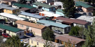 The Eagle River Village mobile home park is shown in Edwards, Colo., on Wednesday, Aug. 28, 2019, The Park is less than 10 miles from world-class skiing at Beaver Creek Resort and represents one of the last bastions of affordable housing in the area. An estimated 100,000 people live in about 900 mobile home parks across Colorado. (AP Photo/Thomas Peipert)