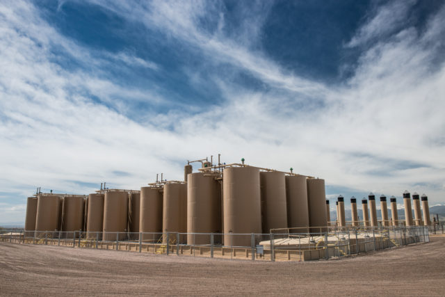 A Crestone Peak oil and gas operation on County Line Road in Weld County. The site contains 16 wells, 40 oil tanks, 26 combustors, 17 separators. (Photo by Ted Wood/The Story Group.)