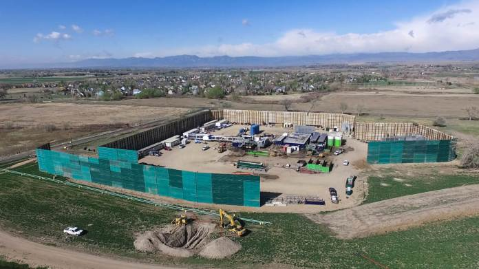 The 15-well site Woolley Becky Sosa development on County Line Road, operated by Crestone Peak Resourced. The drilling is in Weld County but the houses are in Boulder County. (Photo by Adam Stielstra.)