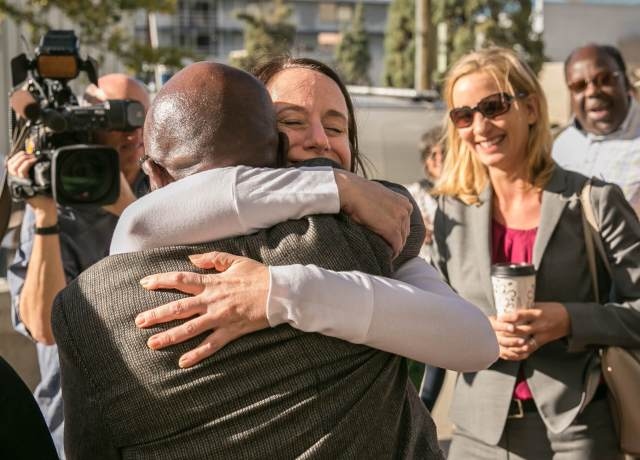 Clarence Moses-EL embraces Colorado Independent editor Susan Greene, who has been reporting on his case for a decade.