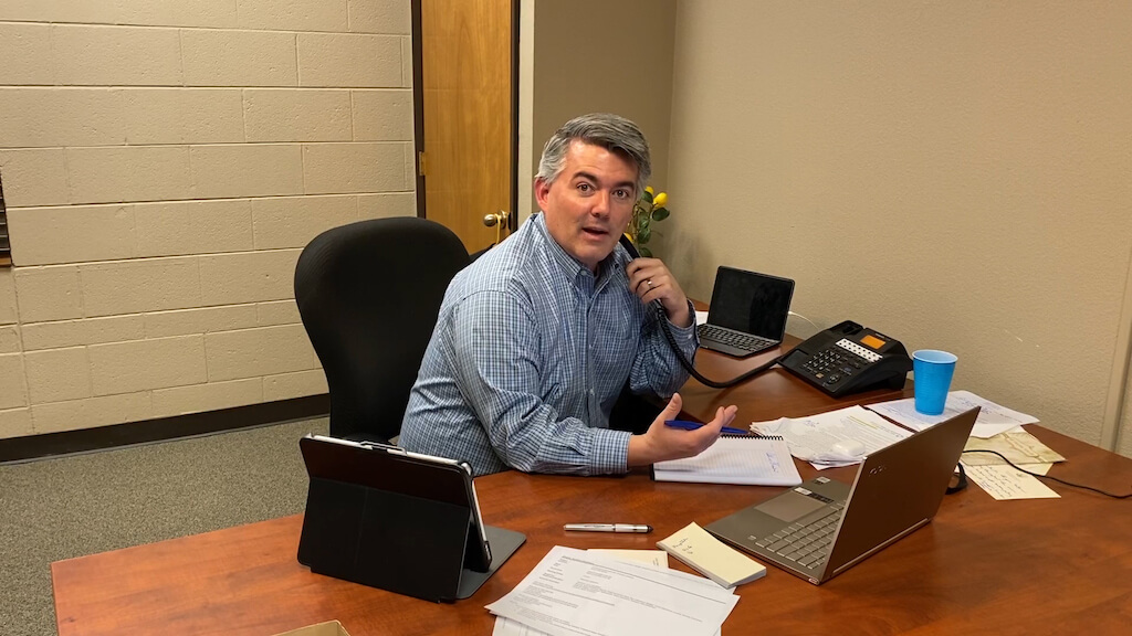U.S. Sen. Cory Gardner on a conference call with President Trump, Vice President Mike Pence and Treasury Secretary Steve Mnuchin. The subject: How to begin reopening America's economy. Gardner took the call from a private office in a coworking space carved from the elementary school he attended. Photo credit: Image taken from video, courtesy of Sen. Cory Gardner