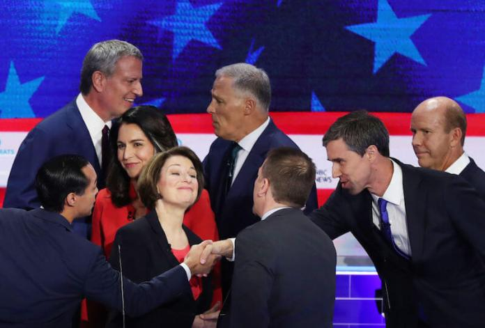 MIAMI, FLORIDA - JUNE 26: Chuck Todd of NBC News greets Sen. Amy Klobuchar (D-MN), former housing secretary Julian Castro, former Texas congressman Beto O'Rourke and other candidates after the first night of the Democratic presidential debate on June 26, 2019 in Miami, Florida. A field of 20 Democratic presidential candidates was split into two groups of 10 for the first debate of the 2020 election, taking place over two nights at Knight Concert Hall of the Adrienne Arsht Center for the Performing Arts of Miami-Dade County, hosted by NBC News, MSNBC, and Telemundo. (Photo by Joe Raedle/Getty Images)