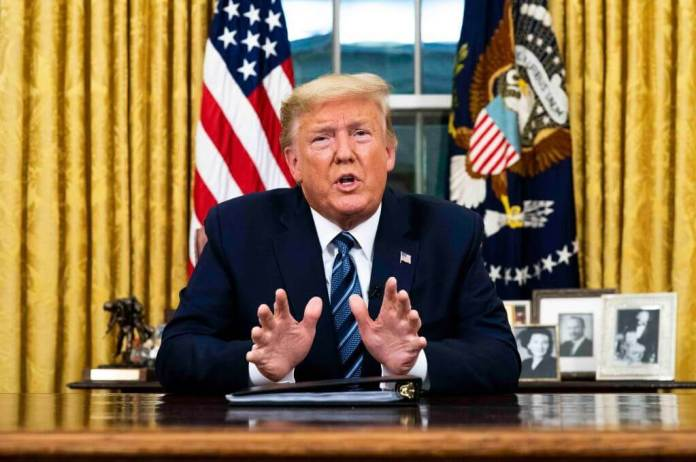 President Donald Trump addresses the Nation from the Oval Office about the widening coronavirus crisis, Wednesday, March, 11, 2020. (POOL PHOTO by Doug Mills/The New York Times) NYTVIRUS