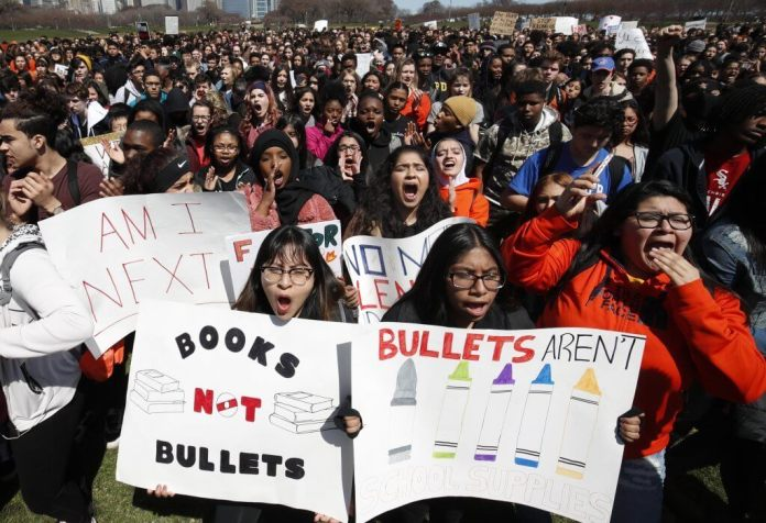 Students gather for a rally while taking part in National School Walkout Day to protest school violence on April 20, 2018 in Chicago, Illinois. Students in Denver, Colorado are expressing similar fears around youth violence. Halfway through the 2019-2020 school year, five DPS students have been killed. | Jim Young/Getty Images