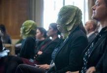 demonstrator wears a Creature from the Black Lagoon mask as David Bernhardt, President Donald Trump's nominee to be Interior Secretary, testifies during a Senate Energy and Natural Resources Committee confirmation hearing on March 28, 2019 in Washington, DC. (Photo by Zach Gibson/Getty Images)