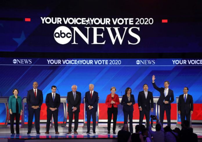HOUSTON, TEXAS - SEPTEMBER 12: Democratic presidential candidates Sen. Amy Klobuchar (D-MN) (L-R), Sen. Cory Booker (D-NJ), South Bend, Indiana Mayor Pete Buttigieg, Sen. Bernie Sanders (I-VT), former Vice President Joe Biden, Sen. Elizabeth Warren (D-MA), Sen. Kamala Harris (D-CA), former tech executive Andrew Yang, former Texas congressman Beto O'Rourke, former housing secretary Julian Castro appear on stage before the start of the Democratic Presidential Debate at Texas Southern University's Health and PE Center on September 12, 2019 in Houston, Texas. Ten Democratic presidential hopefuls were chosen from the larger field of candidates to participate in the debate hosted by ABC News in partnership with Univision. (Photo by Win McNamee/Getty Images)