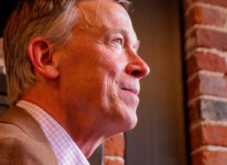 Former Colorado Gov. John Hickenlooper speaks to reporters on Aug. 22, 2019, the day he announced he was running for U.S. Senate.