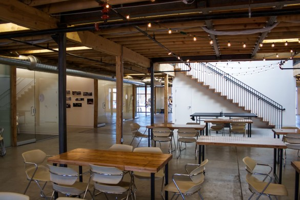 Common space includes desks and staircase built by tres birds of recycled boxcar flooring.