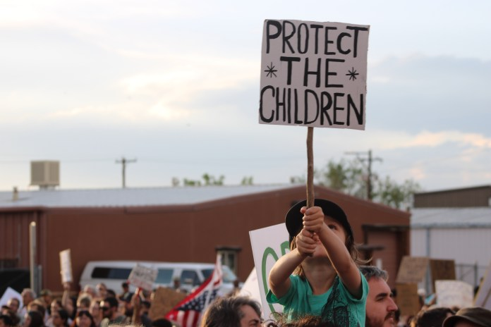 Hundreds of protesters demonstrate against Trump administration immigration policy and private detention facilities at the GEO Group-owned detention facility In Aurora, Colo. on July 12, 2019. (Photo by Cullen Lobe)