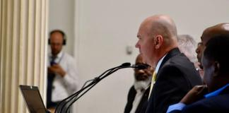 Troy Riggs, director of Denver's Department of Public Safety, testifies on Monday, Aug. 12, 2019, before the state's committee on prison population management. Riggs says he's optimistic that some 500-plus Denverites won't be sent back to jail or prison as a result of the City Council's decision to kill contracts with two private companies that run halfway houses in the city. (Photo by Alex Burness)