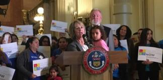 House Education Committee Chair Barbara McLachlan speaks about the benefits of full-day kindergarten with state Rep. Jim Wilson at a small rally for advocates in the Colorado State Capitol.