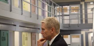 """Dean Williams, the new director of Colorado's Department of Corrections, tours the Centennial South prison for the first time on July 19, 2019. The prison can fit more than 900 people and could be used if the state prison population gets too high. But Williams says he's committed to a """"philosophical"""" shift that, in theory, promises to limit that population growth. (Photo by Alex Burness)"""