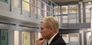 "Dean Williams, the new director of Colorado's Department of Corrections, tours the Centennial South prison for the first time on July 19, 2019. The prison can fit more than 900 people and could be used if the state prison population gets too high. But Williams says he's committed to a ""philosophical"" shift that, in theory, promises to limit that population growth. (Photo by Alex Burness)"
