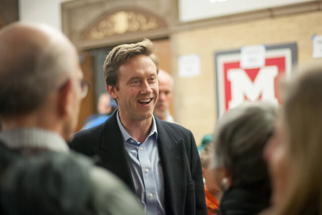 Mike Johnston spoke to Democrats ahead of the precinct meetings at Tuesday's Park Hill caucus at the Smiley Middle School in Denver. March 6, 2018. Photo by John Herrick