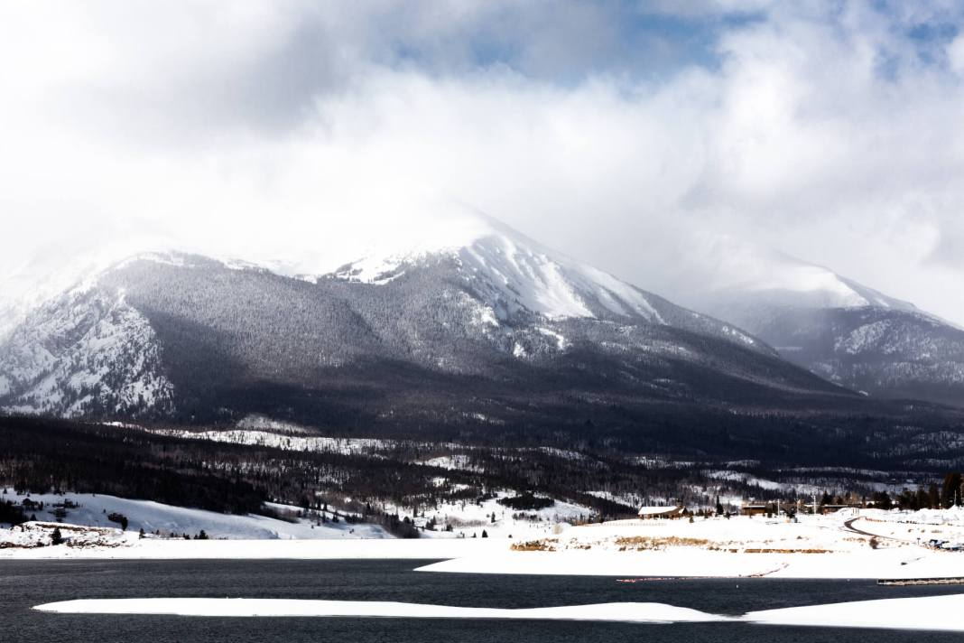 In this COVID-19 pandemic, the first case in Colorado was a visitor to Summit County who had recently been in Italy. (Dillon Reservoir in Summit County, Colorado)