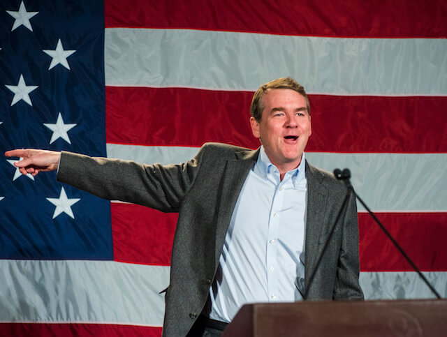 Sen. Michael Bennet speaks at the Westin Downtown Denver in November 2018. (Photograph by Evan Semón for The Colorado Independent)