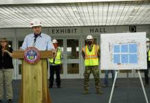 Gov. Jaren Polis answers questions from reporters at the Colorado Convention Center as it is converted into a care site for COVID-19 patients on April 10, 2020. He is aiming to gradually reopen Colorado by April 26. (Photo by Forest Wilson)