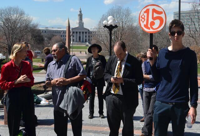 Ricardo Martinez, left, chating at minimum wage protest.