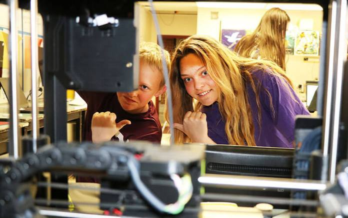 Colorado AeroLab 5th grade students at South Routt County's Soroco Middle School in Oak Creek watch their 3-D models come to life. (Photo by Jody Elston)