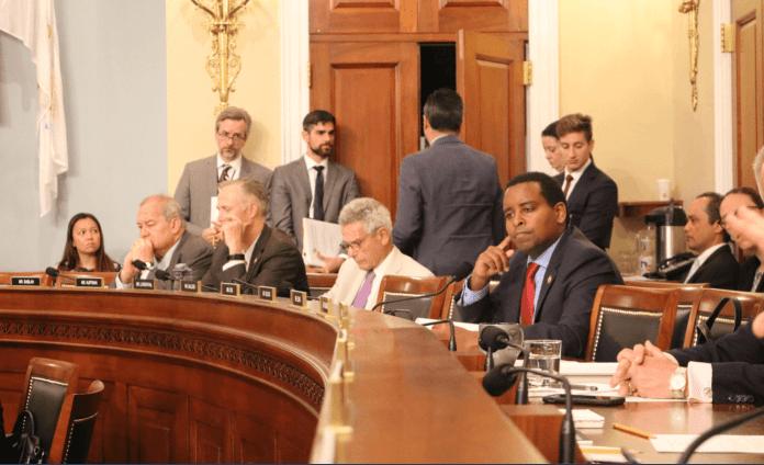 Congressman Joe Neguse (center, right) is pushing the