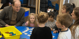 Colorado Gov. Jared Polis chats with preschool students at Village for Early Childhood Education at North in Littleton. (Photo credit: Erica Meltzer/Chalkbeat)