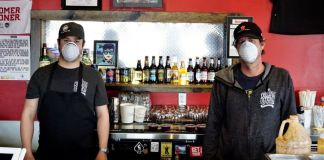 Brett Wenger (left) and Terry Walsh (right) pose for a photo at Rolling Smoke Barbecue in Centennial on April 10, 2020. (Photo by Forest Wilson)