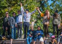 Protesters raise their hands in solidarity at the Climate Strike rally at Civic Center Park on Oct. 11, 2019. (Photo by Evan Semón)