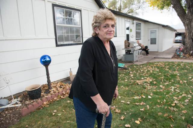 Dawn Stein outside her home in Triple Creek neighborhood, Greeley, Colorado. The access road to the new oil and gas development will be 35 feet from her bedroom window. (Ted Wood/The Story Group)