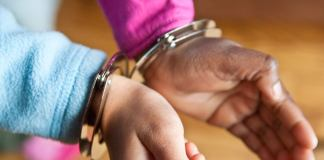 Photo of handcuffed girl by Steven Depolo via Flickr: Creative Commons